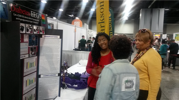 Photo 2-Carlea presenting her research to Dr. Carla Easter of NIH.jpg