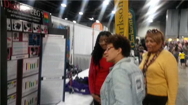 Photo-Carlea presenting her research to Dr. Carla Easter of NIH..jpg